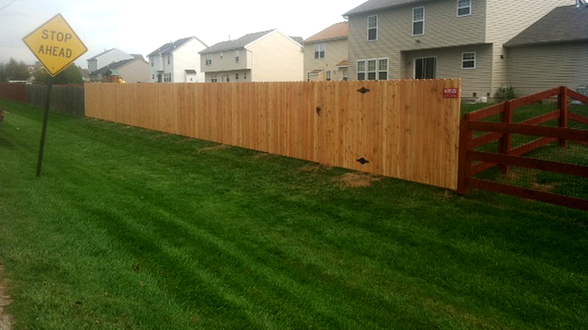 Reclaim your space with a wood privacy fence from Ashlee Fence.