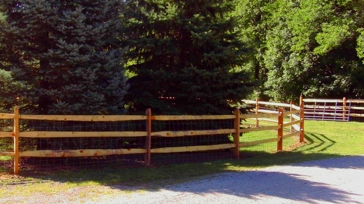 The classic three rail wood fence from Ashlee Fence Company.